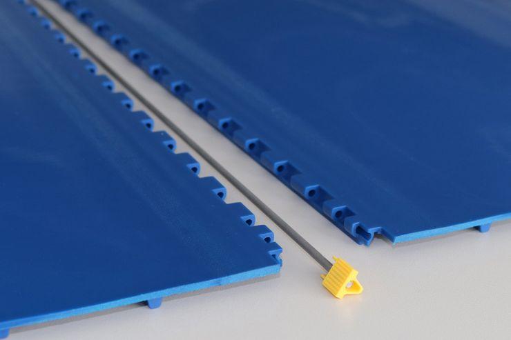 Die Modulbänder lassen sich innerhalb von Sekunden durch manuelles Herausziehen der Kupplungsstäbe öffnen und aus der Anlage entfernen. Bild: Habasit